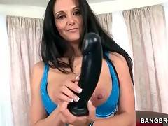 Awesome milf shoves big black dildo inside her eager cunt.